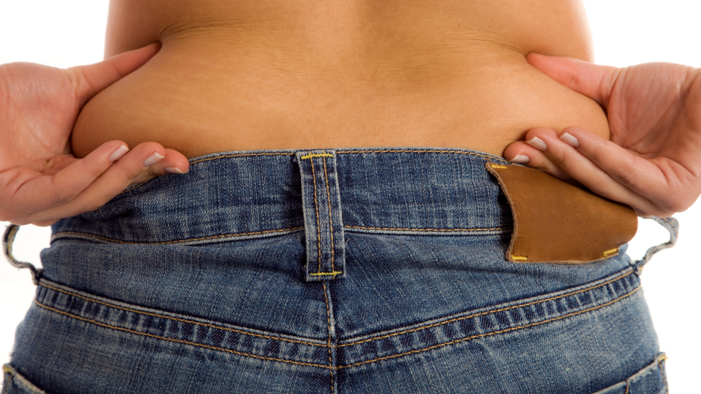 woman pinching her back Visceral Fat