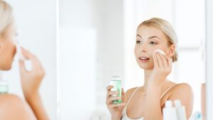 woman cleansing her skin