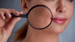 woman holding a magnifying glass over her cheek, skincare concept
